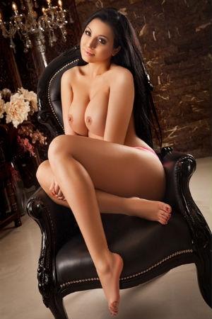 Aleeza naked on a black chair