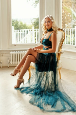 A pretty woman posing for Movida Escorts