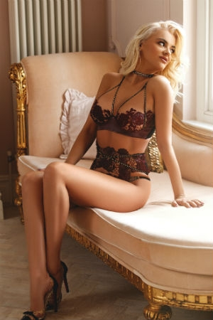 An expensive escort posing for Movida Escorts