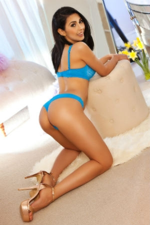 Fatima bent over in blue lingerie