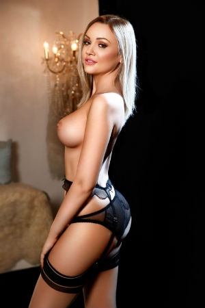 Movida Escort Lolita waring stockings and suspenders.