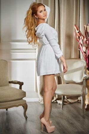 Rosana from Movida Escort waring a white dress.
