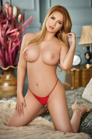 This sexy blonde from Movida Escorts poses in naked breasts.