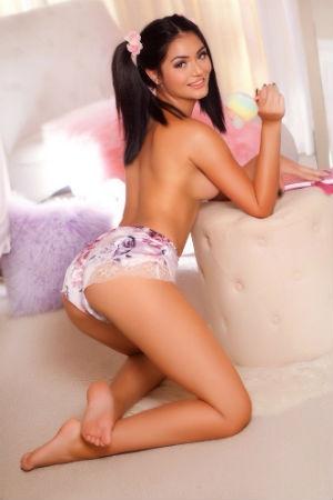 Teenager escort posing for Movida Escorts.