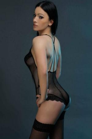 Naughty brunette posing for Movida Escorts
