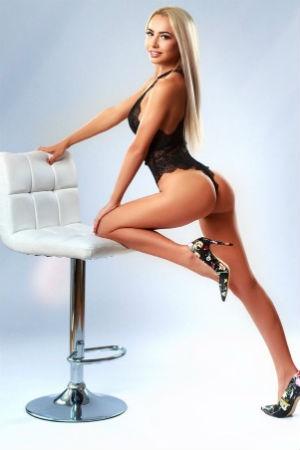 A slim blonde posing for Movida Escorts