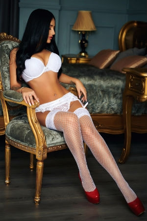 Xandra wearing a white lingerie and stockings