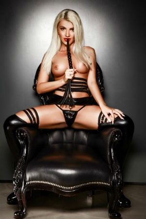Kinky renata on leather chair