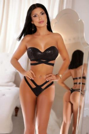 A stunning brunette posing for Movida Escorts