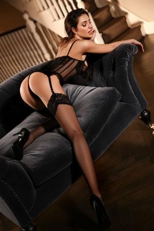 Sia sat on sofa in her black stockings
