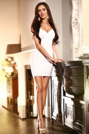 Sia dressed in white dress
