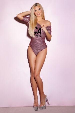Petite lady posing for Movida Escorts