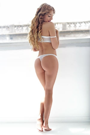 Lena dressed in her white swimsuit