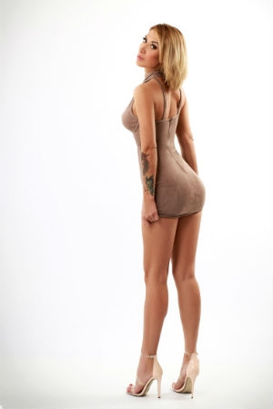 Blonde girl dressed in a tight dress