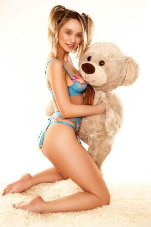 Robin holding a teddy bear