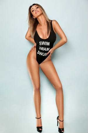 Tall escort posing for Movida Escorts