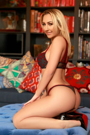 beautiful blonde posing for Movida Escorts