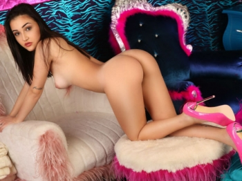 Slim beauty posing for Movida Escorts