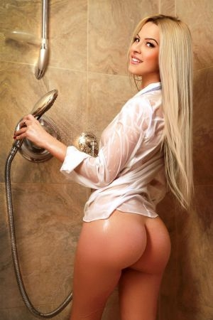 Sexy blonde poses in the shower