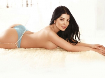 Ivory posing on the floor in blue underwear