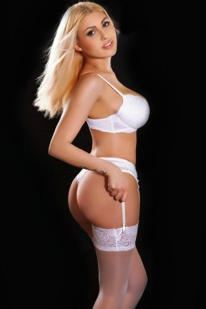 pretty blonde posing for Movida Escorts