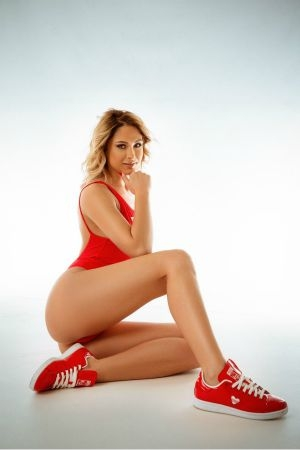 Cataleya wearing red body outfit and sneakers