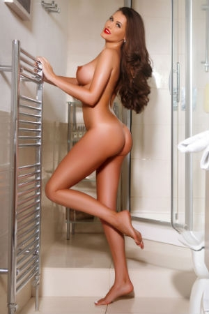 Ria posing naked for Movida Escorts