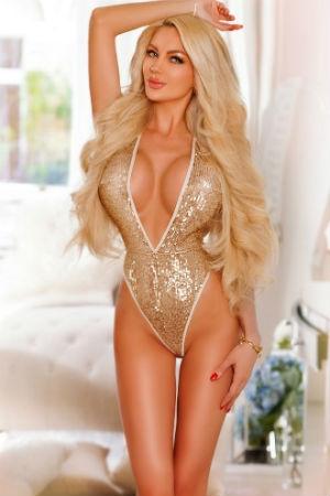 Busy escort posing for Movida Escorts