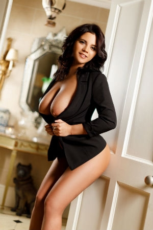 Young escort show her big natural breasts