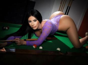 Fantastic brunette sat on the billiard table
