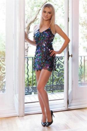 Belinda wearing a sequin dress
