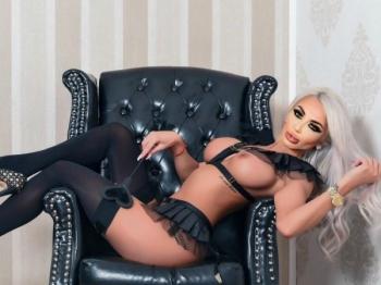 Bijou sitting on a chair wearing black underwear