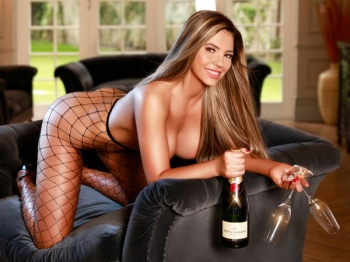 Party girl holding a champagne and 2 glasses