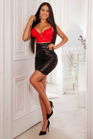Bonita wearing a latex skirt and red bra