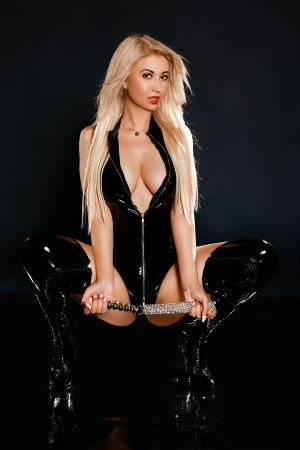 Cute blonde companion Casandra in black dominatrix gear