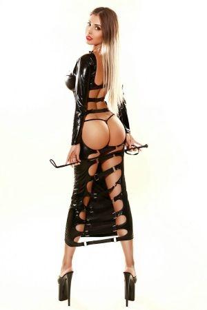 Dominatrix lady wearing a latex dress