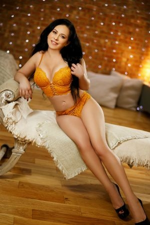 Naty poses for Movida Escorts