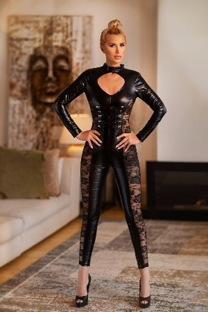 Alina wearing black latex catsuit and high heels