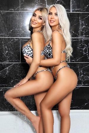 Two blonde hotties wearing leopard print bikinis