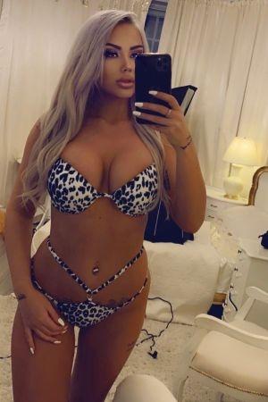 Simone taking a selfie wearing a leopard print bikini