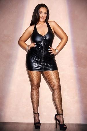 Beverly wearing a black latex dress